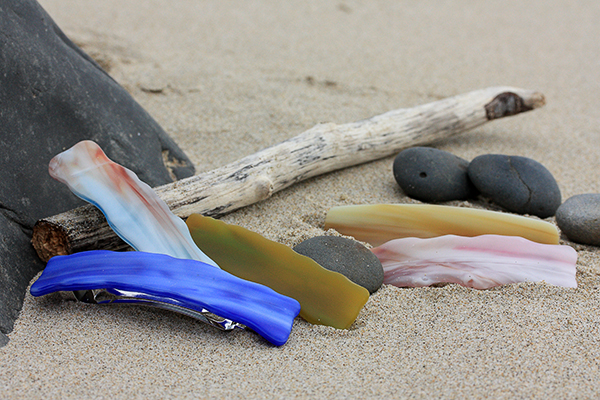 glass barrette weatherd on beach
