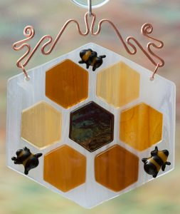 glass honeycomb with bees